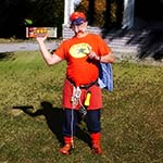 Chuckman, An Online Comic Superhero, Holding A Superhero Beef And Bean Burrito Advertisement