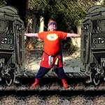 Chuckman, An Online Comic Superhero, Standing Between Two Trains Attempting To Stop A Mathematical Word Problem