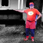 Chuckman, A Superhero, Standing In Front Of Barbeque