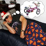 Chuck Dressed In Superman Pajama Bottoms Dreaming of A New Bicycle For Christmas