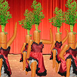 Carrot CanCan Dancers Dressed In Red Dancing On A Stage