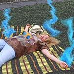 Chuck's Girlfriend Laying On The Ground With Blue Smoke Coming Off Her Body Due To Lightning Strike